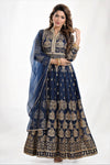 Shop stunning navy blue embroidered georgette Anarkali online in USA with net dupatta. Elevate your ethnic saree style with a tasteful collection of designer lehenga, bridal lehenga, Anarkali, designer salwar suits, Indian dresses, sharara suits from Pure Elegance Indian clothing store in USA.-full view