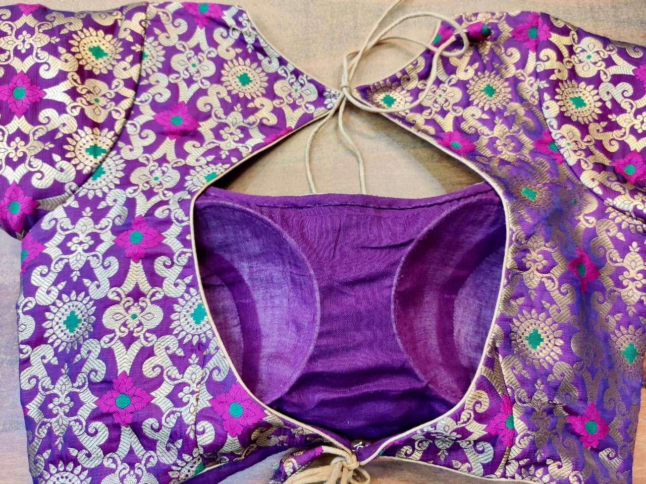 Buy stunning purple Benarasi silk designer saree blouse online in USA. Elevate your ethnic saree style with a tasteful collection of designer saree blouses, embroidered sari blouses, Banarasi blouses, silk saree blouses from Pure Elegance Indian clothing store in USA.-back