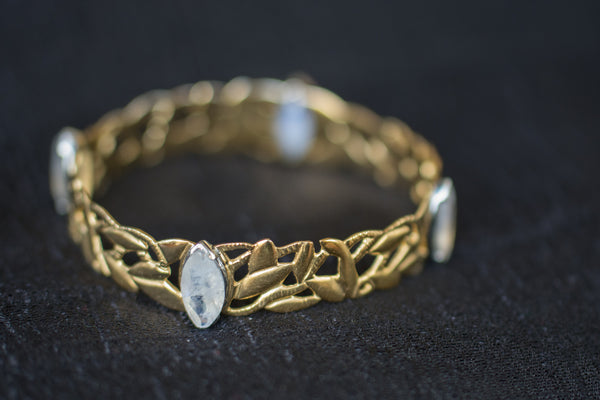 Buy exquisite silver gold plated cutwork bangle online in USA. Browse through exclusive Indian Amrapali jewelry online at Pure Elegance or visit our store in USA.-details