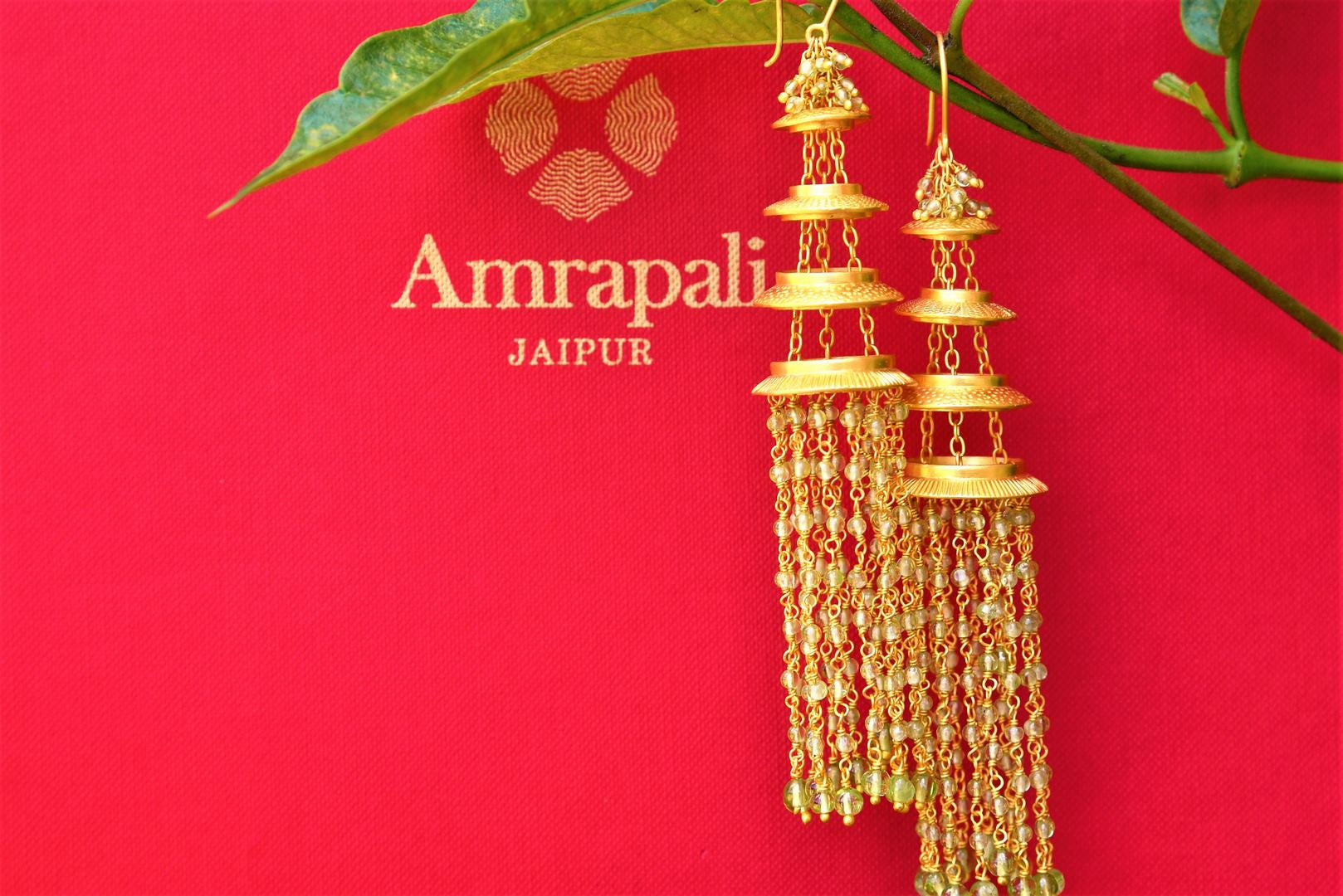 Buy beautiful Silver Gold Plated Dangling Peridot Amrapali Earrings Online from Pure Elegance. Shop gold plated Indian jewelry from our store for women in USA for every occasion.-closeup
