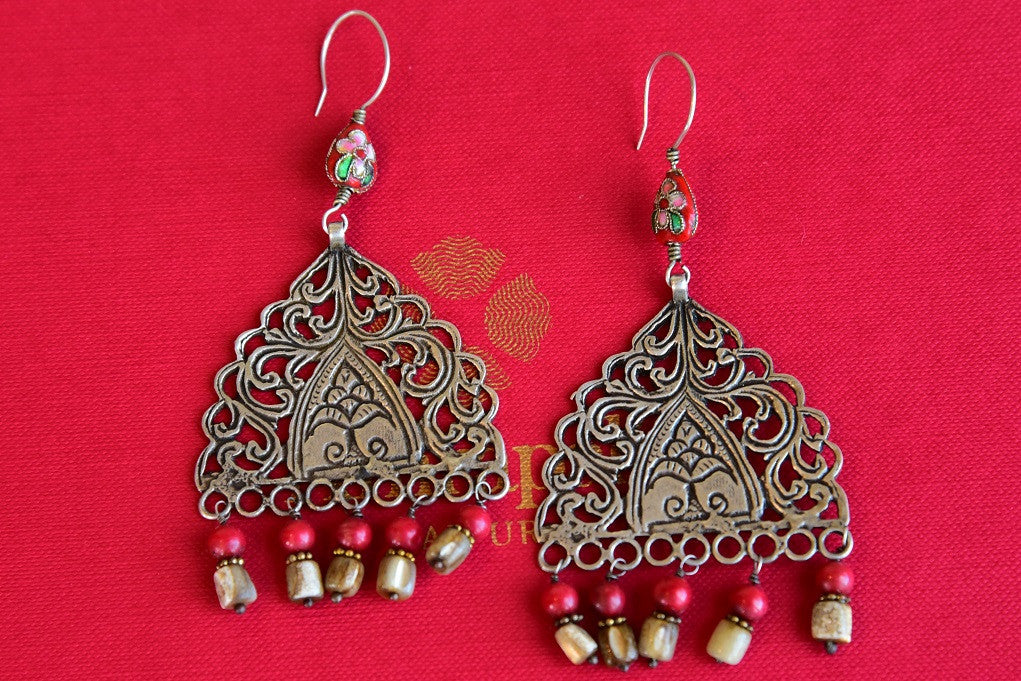 Silver gold plated with glass studded textured earrings. Pair these with western and Indian wear in casual and formal events.-front view
