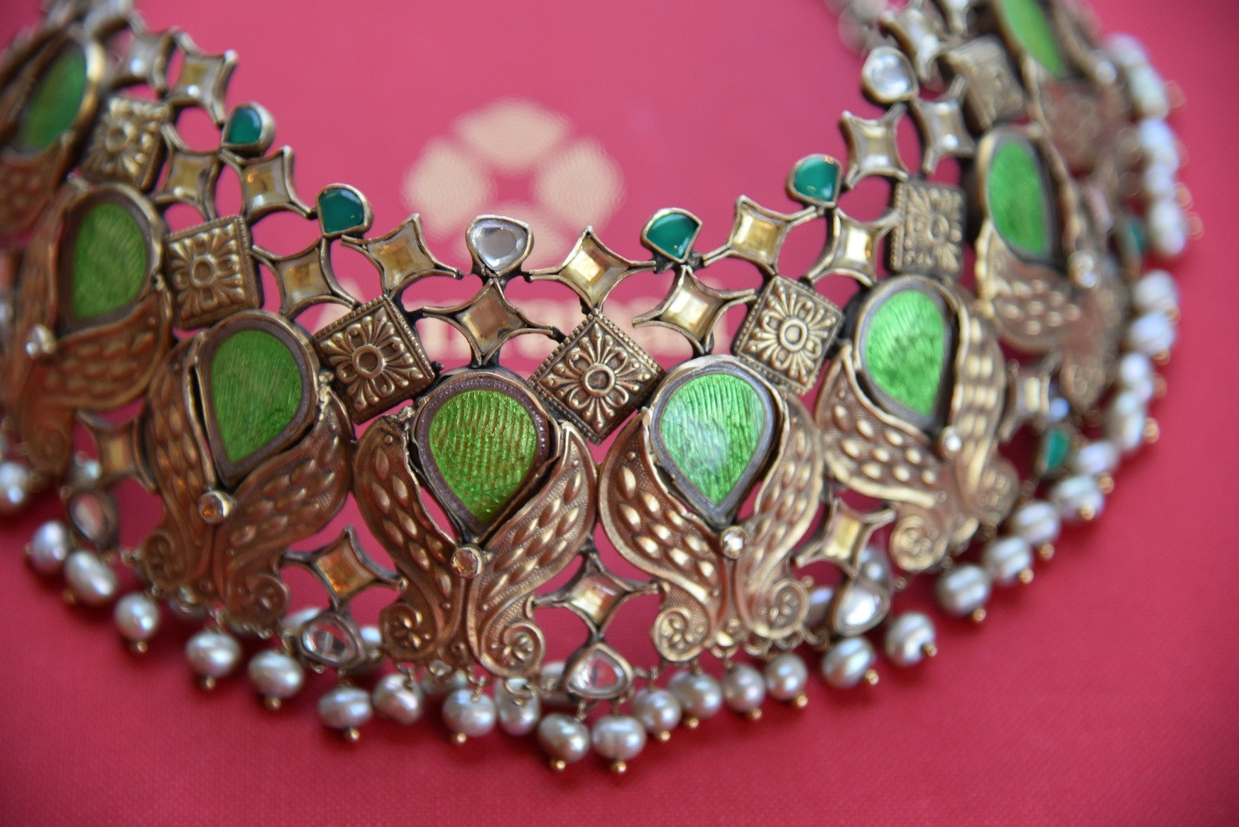 Shop this captivating chunky green and silver fashion jewelry necklace online or from our store near NYC. It is perfect for any wedding, reception, sangeet or reception party.  Close up.