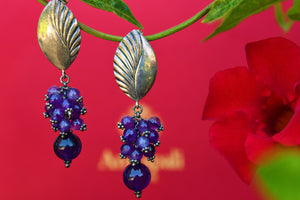 Buy silver Amrapali leaf design earrings online from Pure Elegance. Our fashion store in USA brings an exquisite collection of Indian jewelry earrings in USA for women-closeup