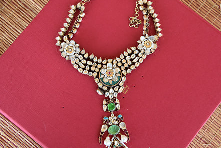 Ethnic as well as classy designer silver gold plated fashion necklace with white and green glass and pearls.- full view