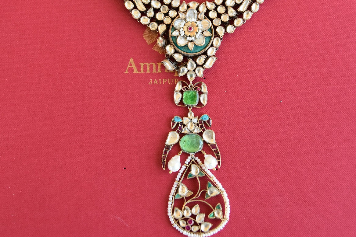 Ethnic as well as classy designer silver gold plated fashion necklace with white and green glass and pearls.- details