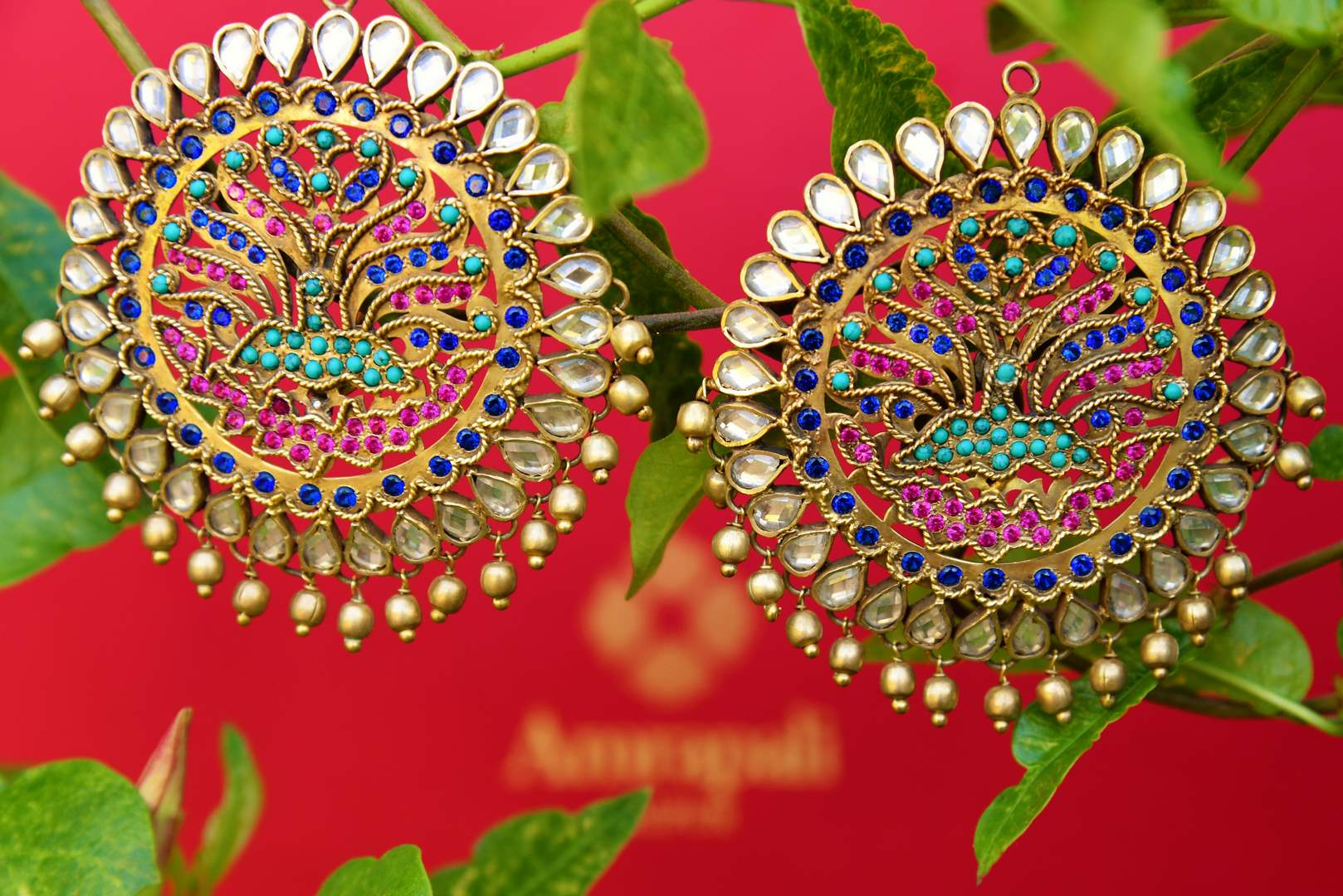 Buy silver gold plated Amrapali stud earrings online from Pure Elegance. Our fashion store in USA brings an exquisite collection of Indian earrings in USA for women-closeup