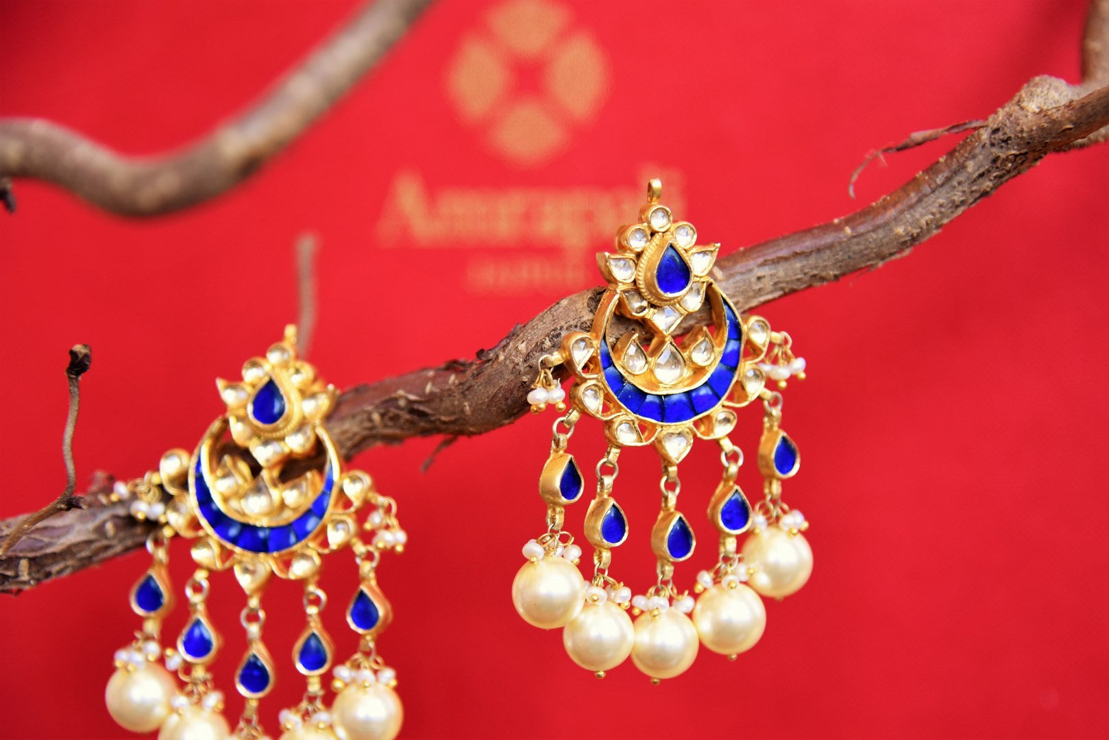 Buy silver gold plated Amrapali blue glass earrings online in USA with pearls drops. Shop ethnic Indian earrings from Pure Elegance store in USA for every occasion.-closeup