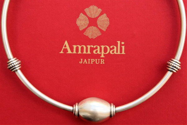 Buy traditional silver Amrapali hasli necklace online in USA. Pure Elegance store brings an exclusive range of handcrafted silver Indian jewelry online for women in USA.-closeup