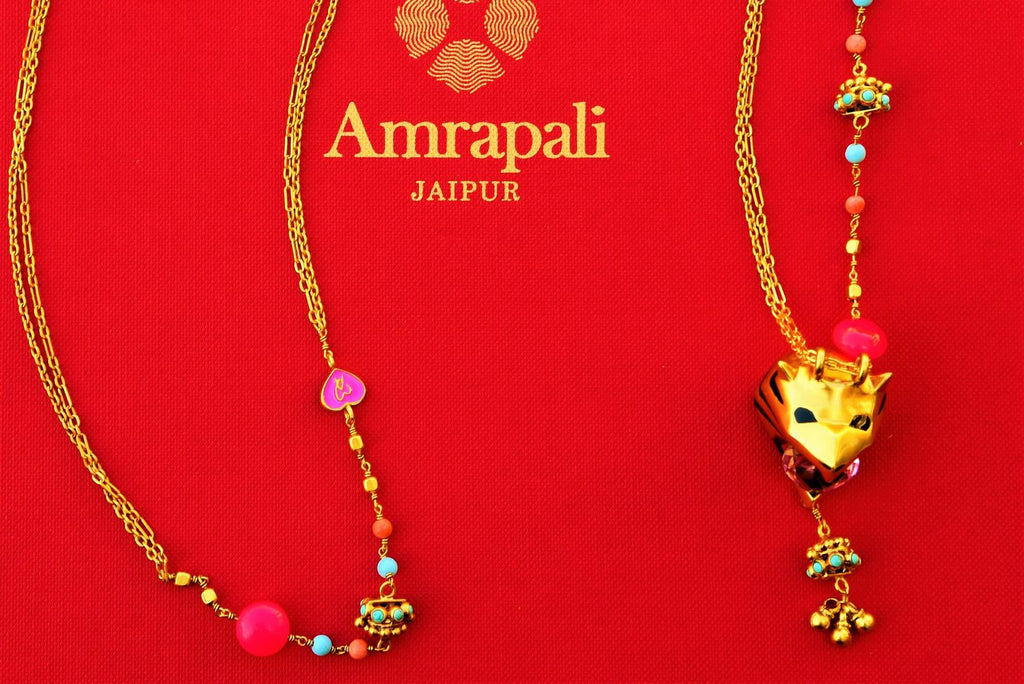 Buy gold plated Amrapali metal necklace online in USA at Pure Elegance. Our fashion store brings an exquisite collection of Indian fashion jewelry in USA for women.-closeup