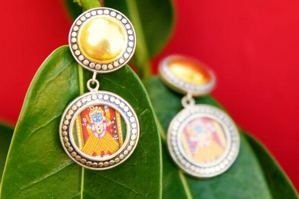 Buy online silver gold plated Amrapali deity painting earrings in USA. Pure Elegance fashion store brings exquisite variety of Indian silver gold plated earrings in USA. -closeup