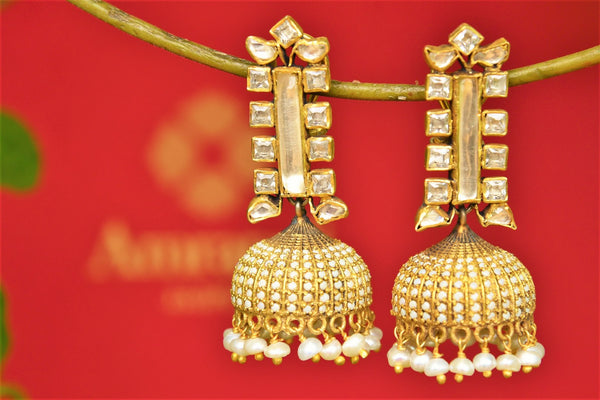 Buy Amrapali silver gold plated zircon and glass jhumka earrings online in USA. Pure Elegance fashion store brings an exquisite range of Indian wedding jewelry in USA.-closeup