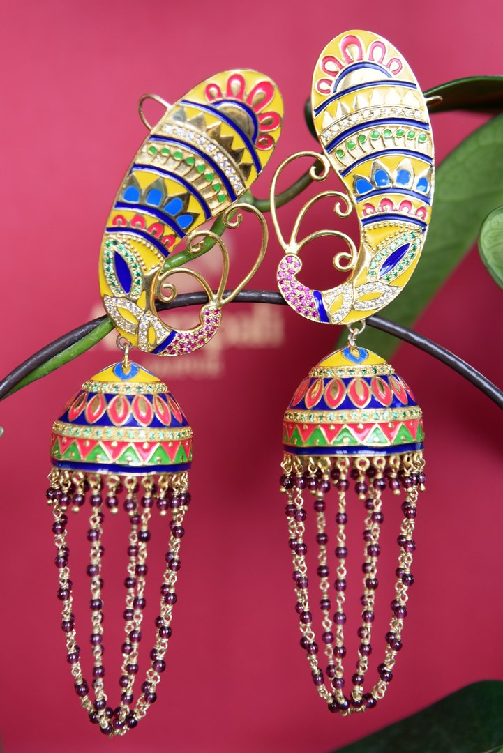 Beautiful Amrapali silver gold plated enamel jhumka earrings buy online in USA. The earrings are decorated with bright enamel work and looped tassels to brighten up your traditional look. Add elegance to your style with more such Indian silver gold plated earrings available at Pure Elegance fashion store in USA or visit online.-full view