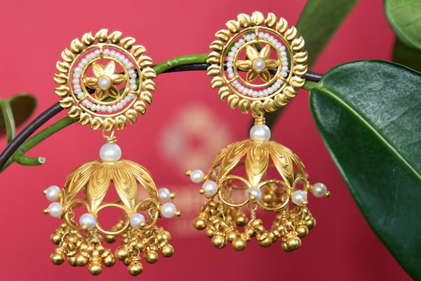 Traditional Amrapali silver gold plated jhumka earrings buy online in USA. The earrings are decorated with pearls to elevate your traditional look. Add elegance to your style with more such Indian silver gold plated earrings available at Pure Elegance fashion store in USA or visit online.-full view