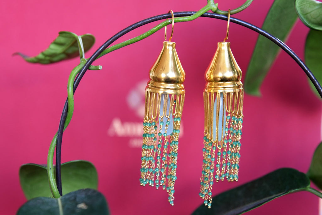 Contemporary design Amrapali silver gold plated earrings buy online in USA. The earrings are decorated with beaded tassels for an Indo-western look. Add elegance to your style with more such Indian silver gold plated earrings available at Pure Elegance fashion store in USA or visit online.-full view