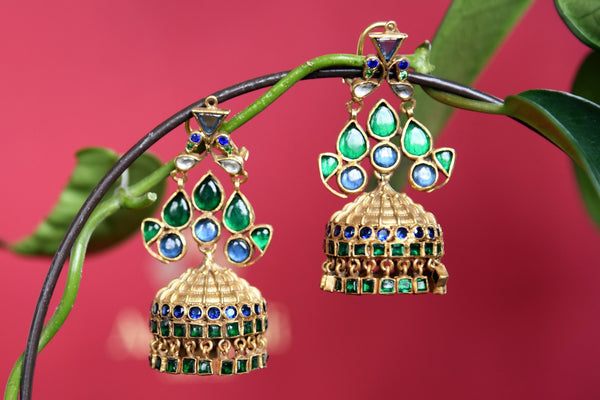 Beautiful silver gold plated glass jhumka earrings from Amrapali buy online in USA. The earrings are a stunner with blue and green glass which makes them so captivating. Add elegance to your style with more such Indian wedding jewelry available at Pure Elegance fashion store in USA or visit online.-full view