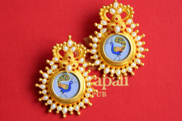 Buy Amrapali silver gold plated peacock painting earrings with pearls online in USA. Pure Elegance fashion store brings an exclusive range of Indian jewelry in USA. -closeup