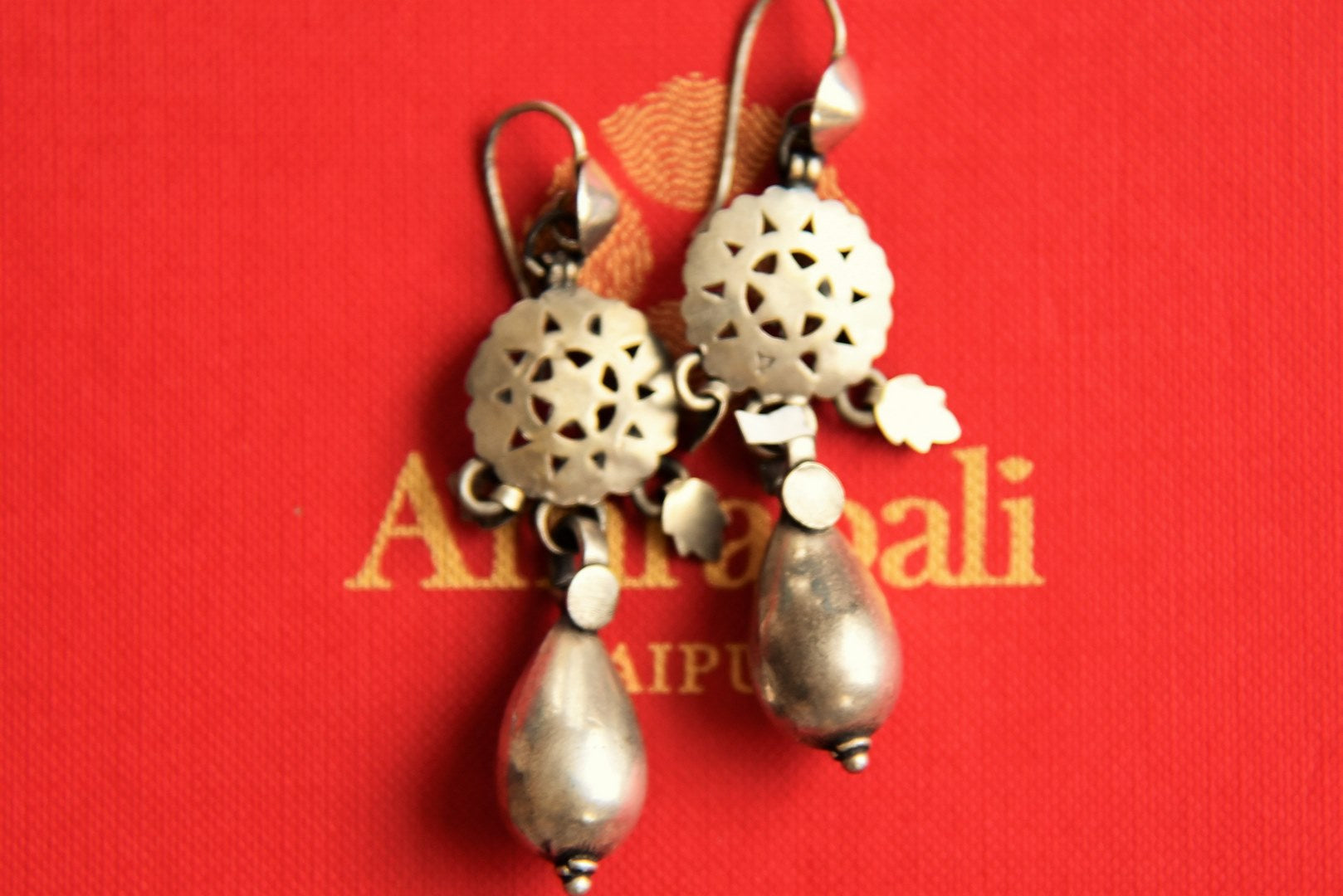 Shop Amrapali silver earrings online in USA with silver bead. Pure Elegance fashion store brings an exclusive range of Indian silver jewelry in USA. Shop online.-closeup