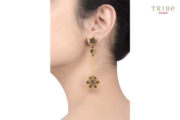 Buy elegant silver gold plated dual tone star flower drop earrings online in USA by Tribe Amrapali. The earrings are a unique jewelry piece to add a spark to your look. If you want to shop such ethnic Indian silver gold plated jewelry in USA, then look no further than Pure Elegance exclusive fashion store.-ear view