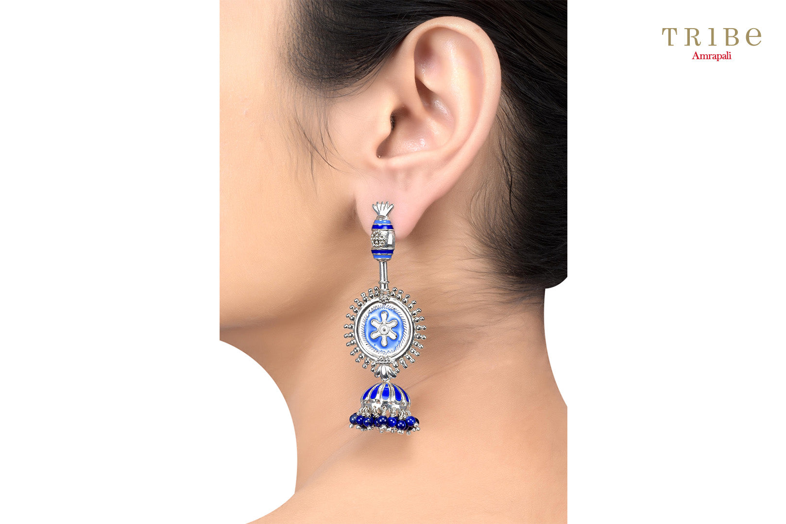 Beautiful Tribe Amrapali floral rawa lapis enameled silver jhumki earrings buy online in USA.  If you want to shop such ethnic Indian silver jewelry in USA, then look no further than Pure Elegance exclusive fashion store or shop online.-ear view