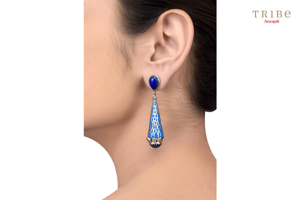 Tribe Amrapali textured enameled lapis studded conical silver earrings buy online in USA.  If you want to shop such ethnic Indian silver earrings in USA, then look no further than Pure Elegance exclusive fashion store or shop online.-ear view