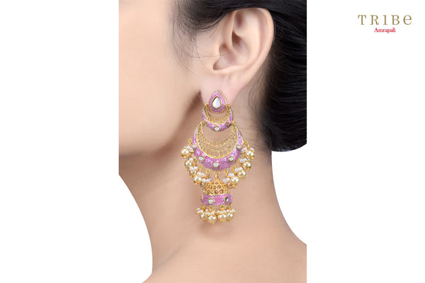 Beautiful gold plated pink double crescent moon jhumka earrings buy online in USA.  Adorn your ears with these absolutely stunning earrings at weddings and special occasions. If you are looking for Indian jewelry in USA, then Pure Elegance clothing store is your one stop solution, shop now.-ear view