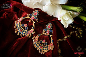 Buy beautiful silver gold plated pink and blue glass chandbali earrings online in USA from Amrapali. The earrings are an alluring match to traditional Indian attires at weddings. Shop more such gorgeous Indian silver gold plated earrings in USA at Pure Elegance, you can visit our exclusive fashion store in USA or shop online.-flatlay