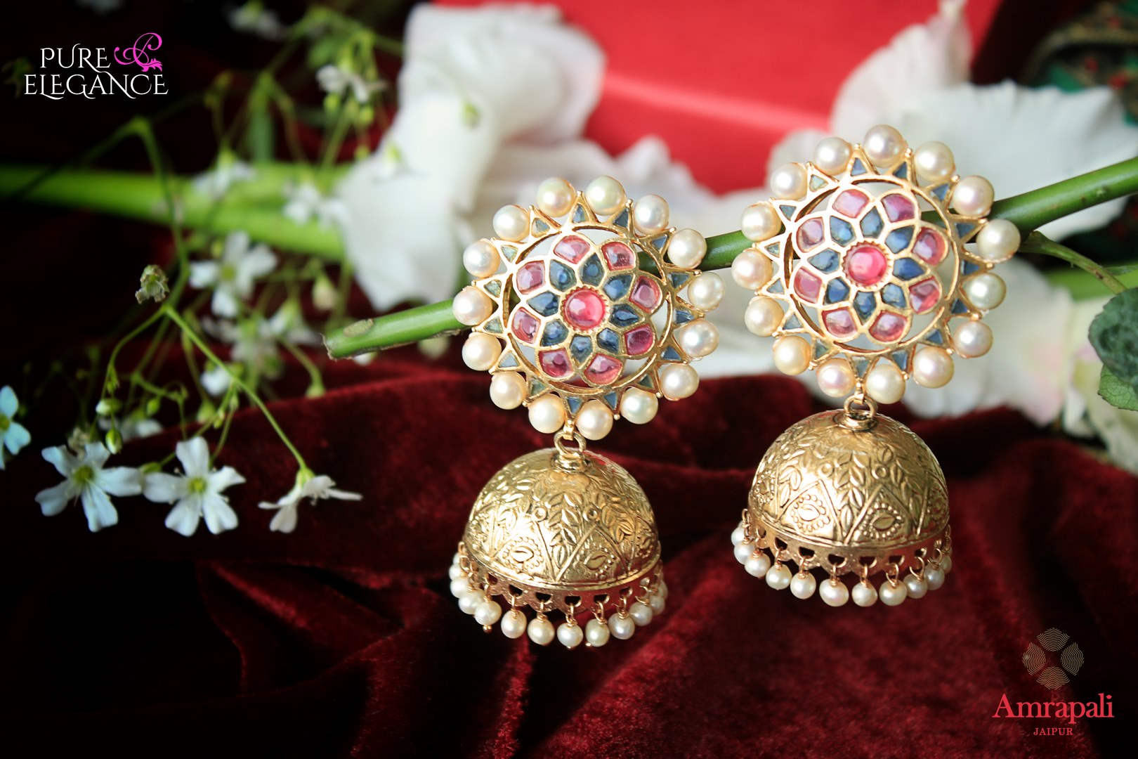 Buy silver gold plated glass jhumki earrings online in USA from Amrapali. Stand out amongst all with these exquisite earrings at weddings and special occasions. Shop more such gorgeous Indian silver gold plated jewellery in USA at Pure Elegance, you can visit our exclusive fashion store in USA or shop online.-flatlay