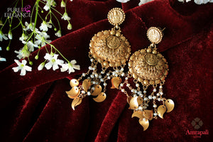 Buy antique silver gold plated earrings online in USA from Amrapali. Add a traditional touch to your Indian look at weddings with these one of a kind earrings. Shop more such gorgeous Indian jewelry in USA at Pure Elegance, you can visit our exclusive fashion store in USA or shop online.-flatlay
