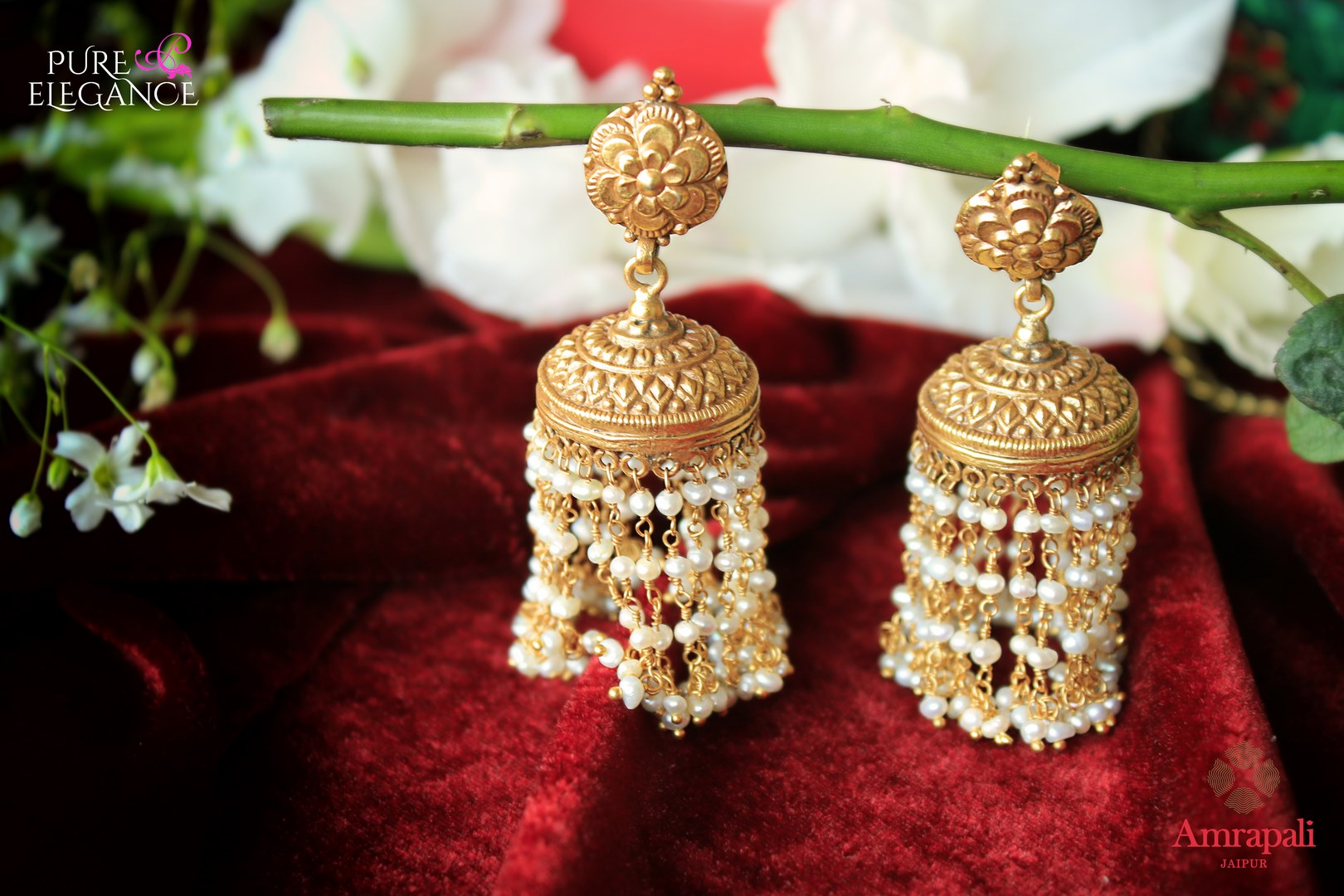 Buy ethnic Amrapali silver gold plated earrings online in USA with pearl tassels. Add a unique touch to your Indian look at special occasions with these gorgeous earrings. Shop more such exquisite Indian jewelry in USA at Pure Elegance, you can visit our exclusive fashion store in USA or shop online.-flatlay