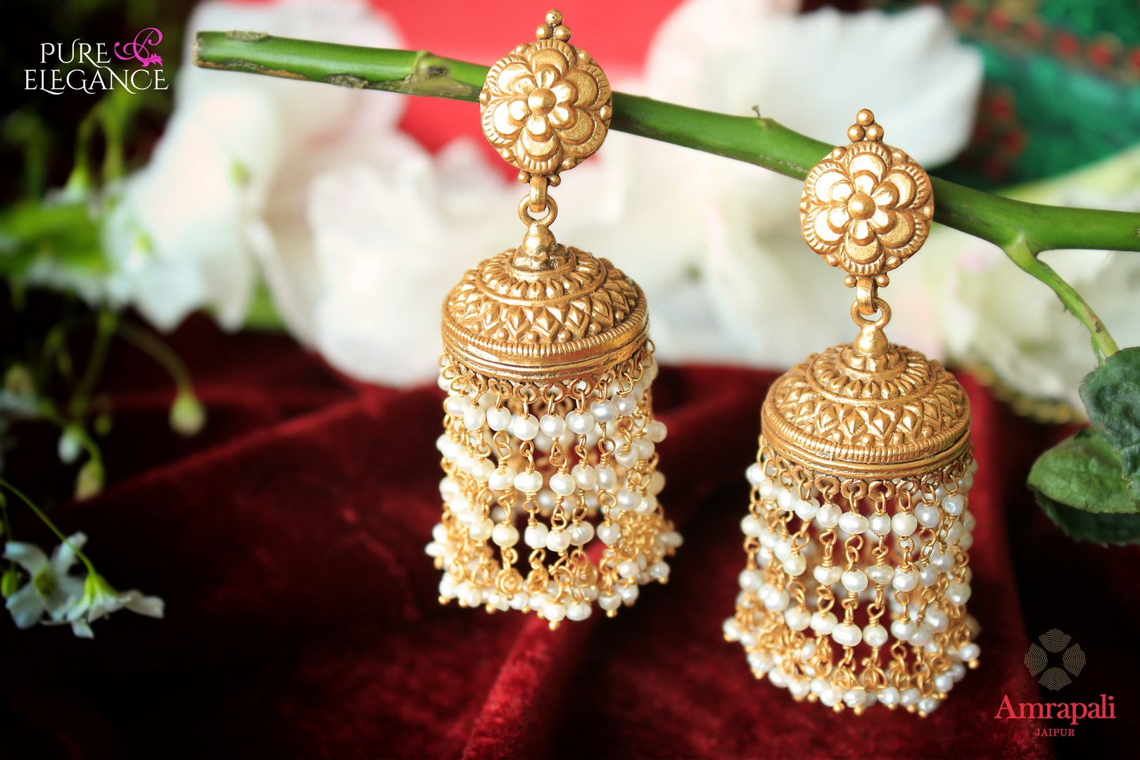 Buy ethnic silver gold plated earrings online in USA with pearl tassels. Add a unique touch to your Indian look at special occasions with these stunning earrings. Shop more such exquisite Amrapali jewelry in USA at Pure Elegance, you can visit our exclusive fashion store in USA or shop online.-flatlay