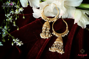 Buy ethnic silver gold plated bali earrings online in USA with pearl tassels. Add a unique touch to your Indian look at special occasions with these alluring earrings. Shop more such exquisite Amrapali jewelry in USA at Pure Elegance, you can visit our exclusive fashion store in USA or shop online.-flatlay