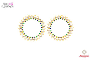 Buy stylish silver gold plated glass hoop earrings online in USA from Amrapali. Add a unique touch to your Indian look at special occasions with these gorgeous earrings. Shop more such exquisite Indian fashion jewelry in USA at Pure Elegance, you can visit our exclusive fashion store in USA or shop online.-front look