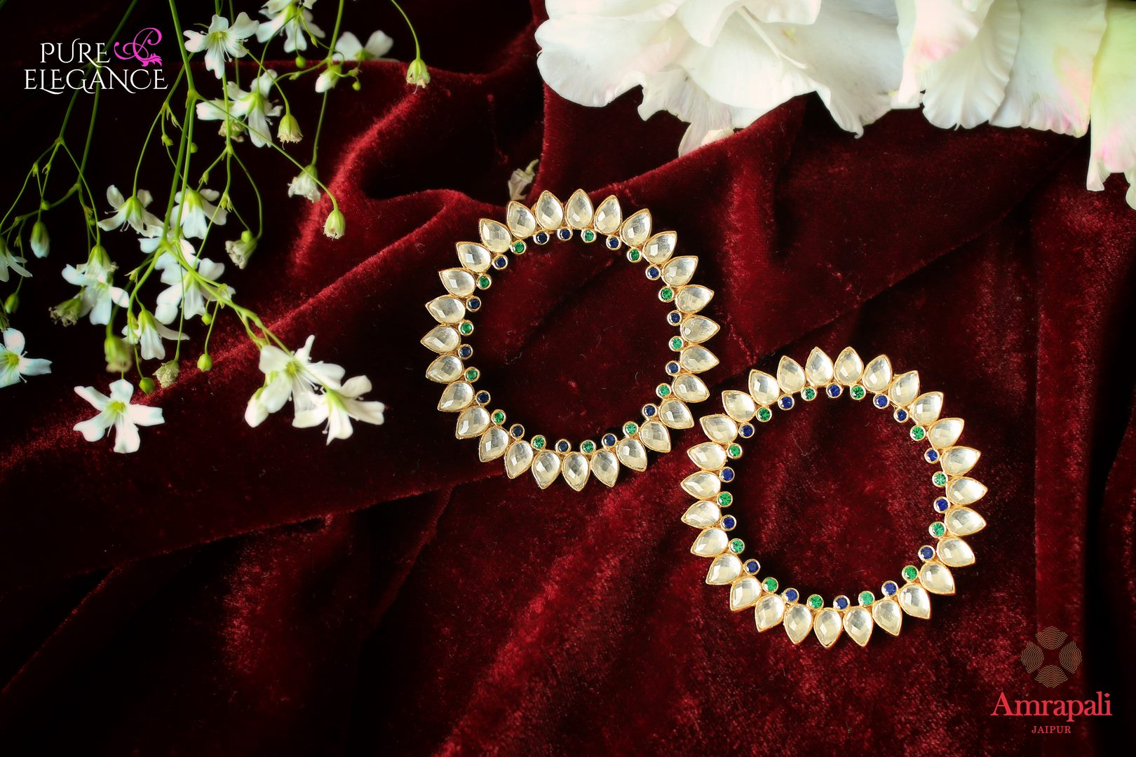 Buy stylish silver gold plated glass hoop earrings online in USA from Amrapali. Add a unique touch to your Indian look at special occasions with these gorgeous earrings. Shop more such exquisite Indian fashion jewelry in USA at Pure Elegance, you can visit our exclusive fashion store in USA or shop online.-flatlay