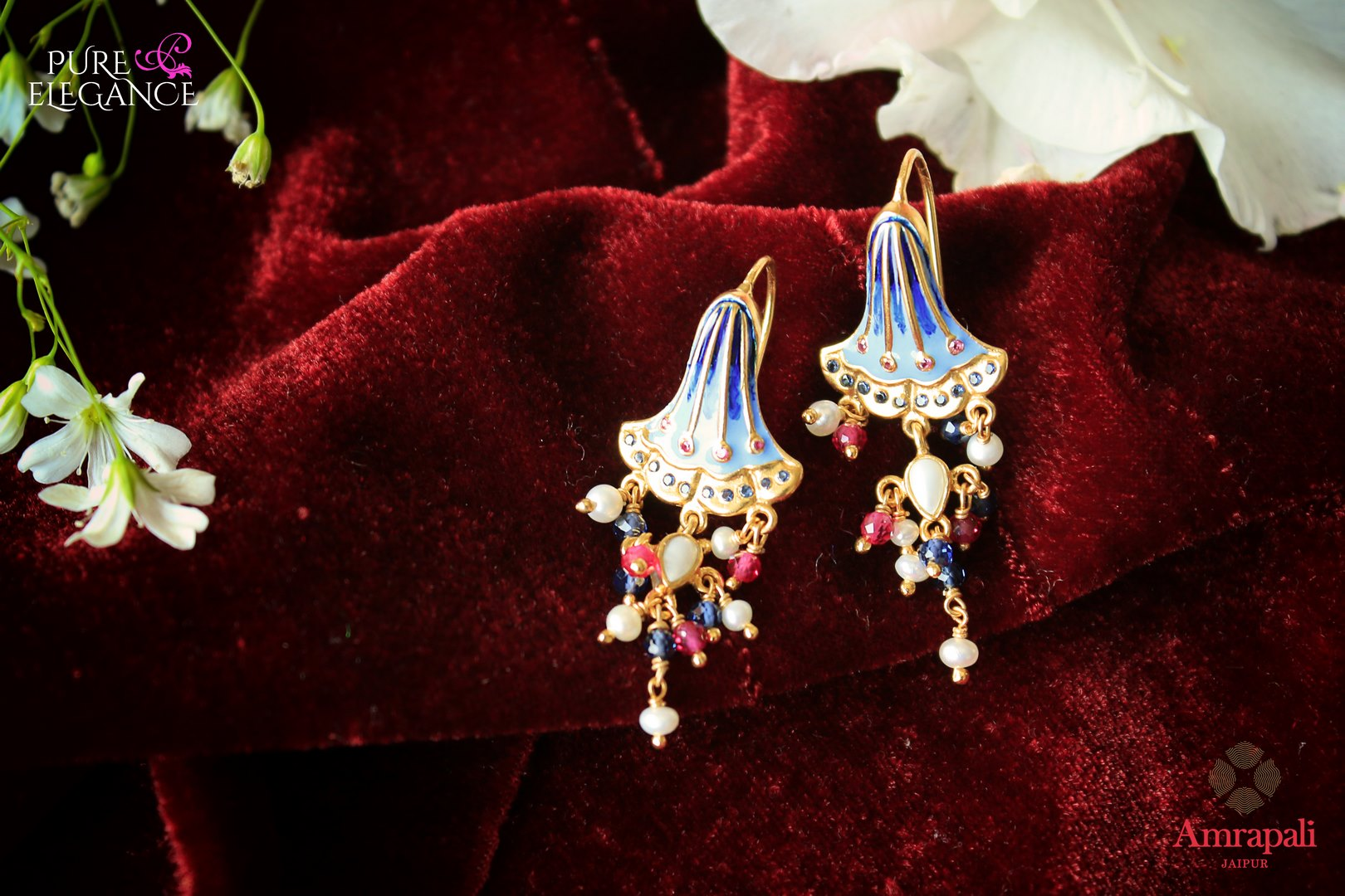 Buy silver gold plated enamel earrings online in USA with colorful beads. Add a unique touch to your Indian look at special occasions with these alluring earrings. Shop more such exquisite Amrapali jewelry in USA at Pure Elegance, you can visit our exclusive fashion store in USA or shop online.-flatlay