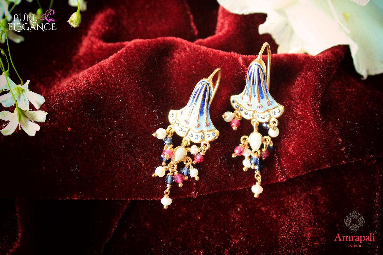 Buy Amrapali silver gold plated enamel blue bell earrings online in USA. If you are looking for Indian jewelry in USA, then Pure Elegance Indian fashion store is the place for you. A whole range of exquisite silver gold plated earrings, necklaces is waiting for you on our shelves, you can also opt to shop online.-flat lay