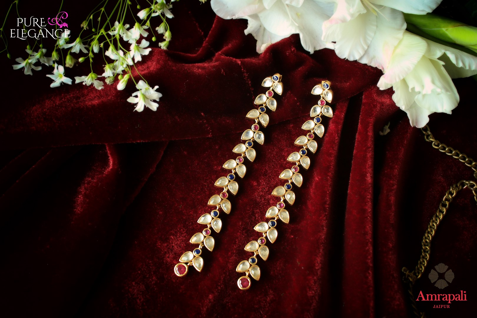 Buy Amrapali silver gold plated leaf string glass earrings online in USA. If you are looking for Indian jewelry in USA, then Pure Elegance Indian fashion store is the place for you. A whole range of exquisite silver gold plated earrings, necklaces is waiting for you on our shelves, you can also opt to shop online.-flat lay
