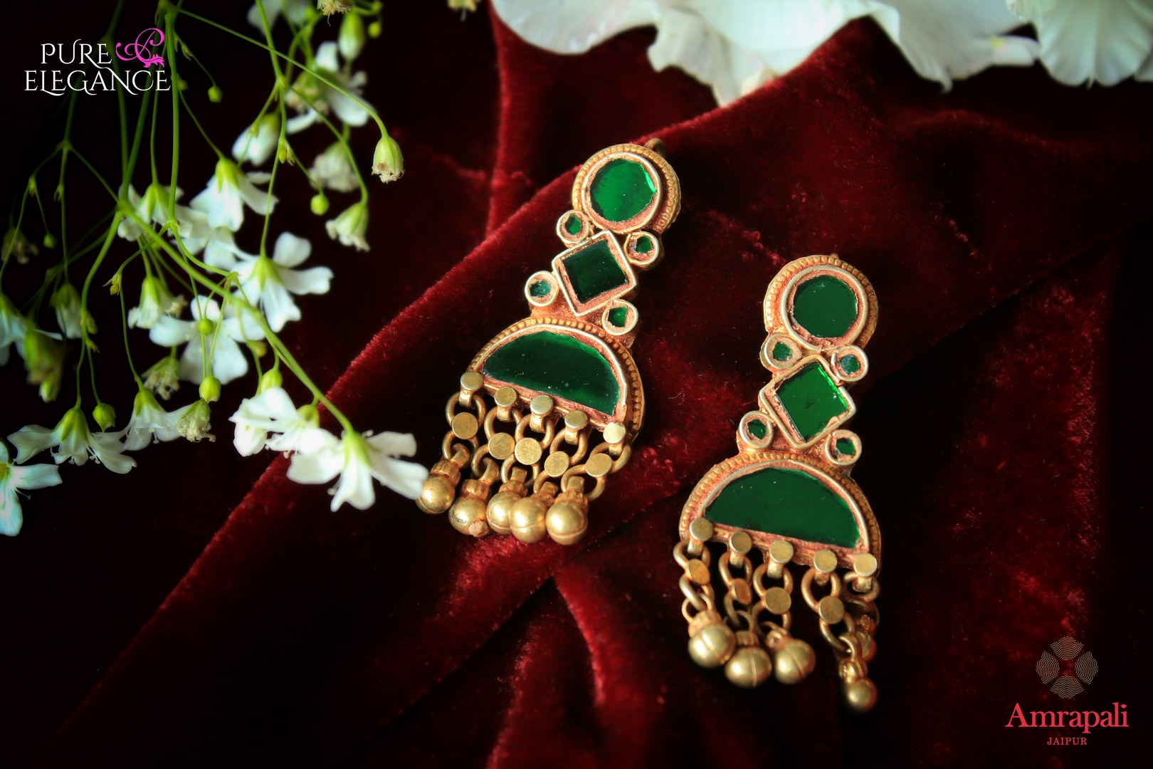 Buy beautiful silver gold plated green glass earrings online in USA from Amrapali. If you are looking for Indian jewellery in USA, then Pure Elegance Indian fashion store is the place for you. A whole range of exquisite silver gold plated earrings, necklaces are waiting for you on our shelves, you can also opt to shop online.-flat lay