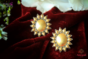 Buy elegant silver gold plated flower design stud earrings online in USA from Amrapali. If you are looking for Indian silver gold plated earrings in USA, then Pure Elegance Indian fashion store is the place for you. A whole range of exquisite of ethnic Indian jewelry is waiting for you on our shelves, you can also opt to shop online.-flat lay