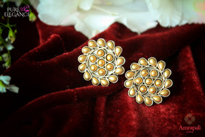 Silver gold plated flower design stud earrings buy online in USA from Amrapali. If you are looking for Indian silver gold plated earrings in USA, then Pure Elegance Indian fashion store is the place for you. A whole range of exquisite of ethnic Indian jewelry is waiting for you on our shelves, you can also opt to shop online.-flat lay