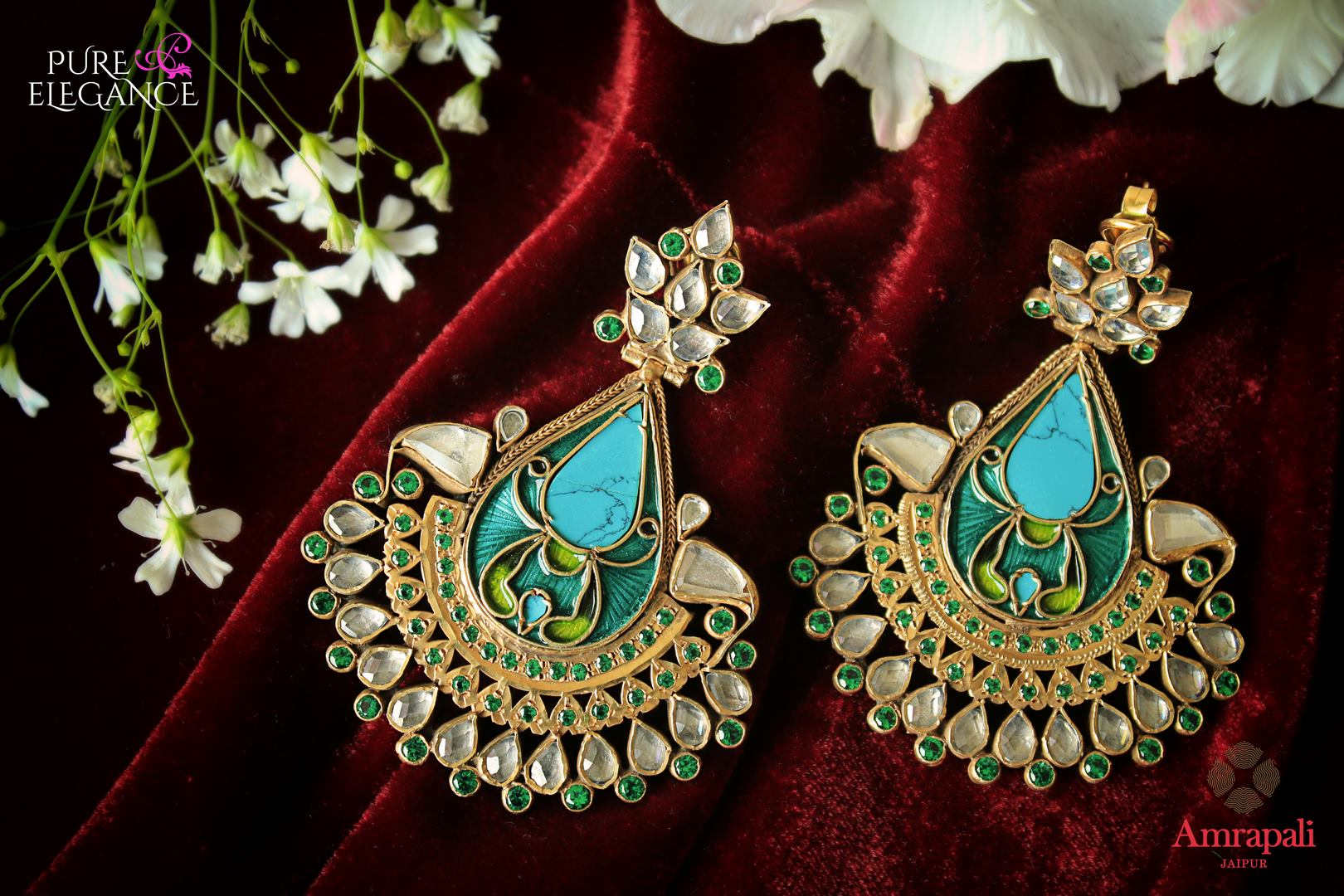 Beautiful silver gold plated enamel glass earrings buy online in USA from Amrapali. If you are looking for Indian earrings in USA, then Pure Elegance Indian fashion store is the place for you. A whole range of exquisite of ethnic Indian wedding jewelry is waiting for you on our shelves, you can also opt to shop online.-flat lay