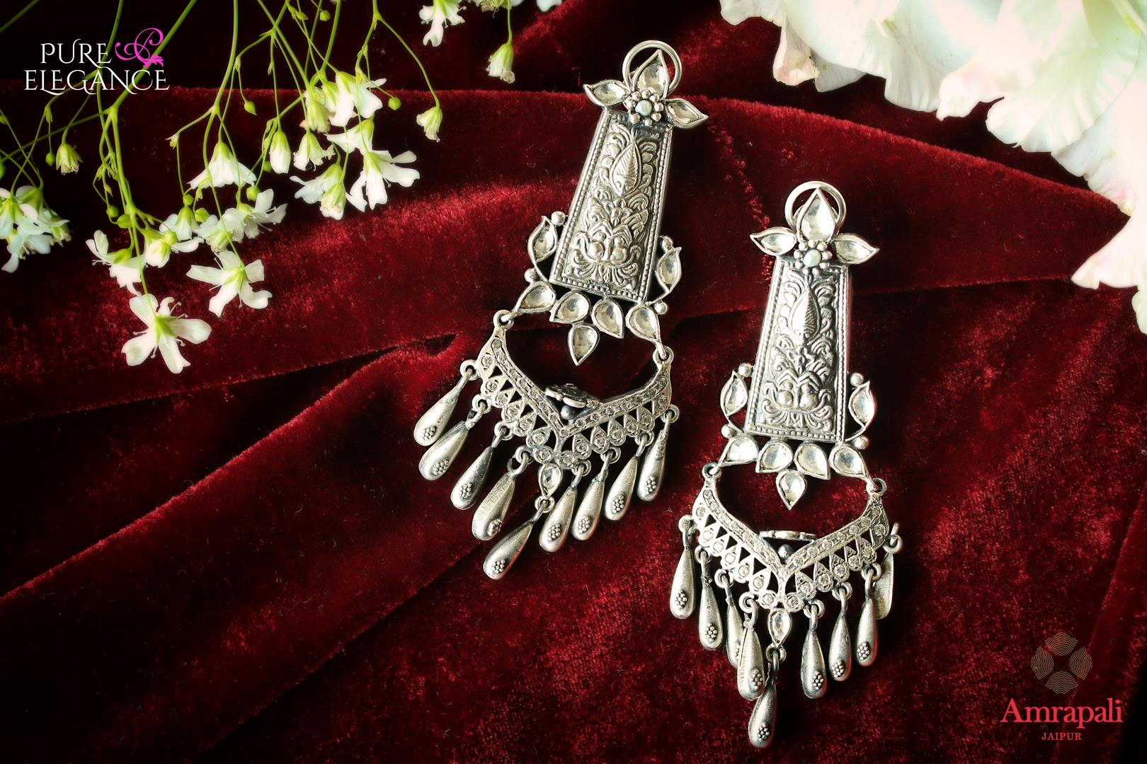 Buy Magnificent Silver Earrings With White Glass online in USA from Amrapali.  If you are looking for Indian silver earrings in USA, then Pure Elegance Indian fashion store is the place for you. A whole range of exquisite of ethnic Indian jewelry is waiting for you on our shelves, you can also opt to shop online.-flat lay