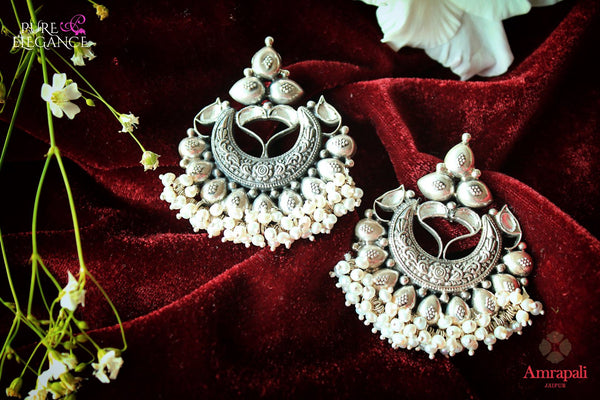 Buy Silver Pearl Drops Glass Chandbali Earrings online in USA from Amrapali.  If you are looking for Indian silver earrings in USA, then Pure Elegance Indian fashion store is the place for you. A whole range of exquisite of ethnic Indian jewelry is waiting for you on our shelves, you can also opt to shop online.-flat lay