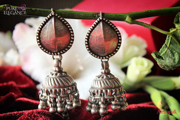 Buy online Silver Tribal Jhumka Earrings in USA from Amrapali.  If you are looking for Indian silver earrings in USA, then Pure Elegance Indian fashion store is the place for you. A whole range of exquisite of ethnic Indian jewelry is waiting for you on our shelves, you can also opt to shop online.-flat lay