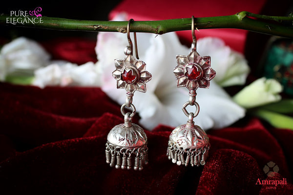 Buy Silver Red Glass Jhumka Earrings online in USA from Amrapali.  If you are looking for Indian silver earrings in USA, then Pure Elegance Indian fashion store is the place for you. A whole range of exquisite of ethnic Indian jewelry is waiting for you on our shelves, you can also opt to shop online.-flat lay