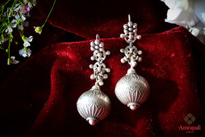 Buy Silver Floral Textured Hanging Ball Earrings online in USA from Amrapali.  If you are looking for Indian silver earrings in USA, then Pure Elegance Indian fashion store is the place for you. A whole range of exquisite of ethnic Indian jewelry is waiting for you on our shelves, you can also opt to shop online.-flat lay