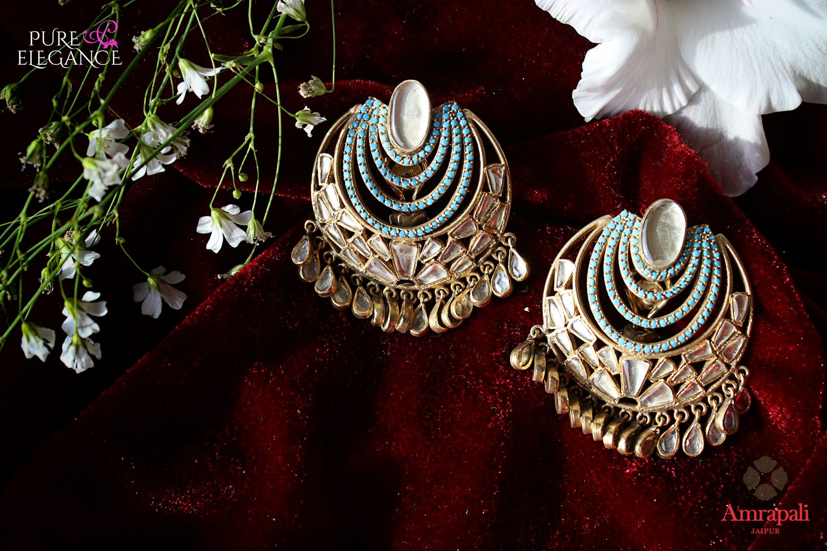Buy Silver Gold Plated Glass Blue Zircon Earrings online in USA from Amrapali.  If you are looking for Indian silver earrings in USA, then Pure Elegance Indian fashion store is the place for you. A whole range of exquisite of ethnic Indian jewelry is waiting for you on our shelves, you can also opt to shop online.-flat lay