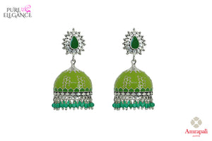 Shop Amrapali green enamel silver jhumka earrings online in USA with green beads. Bring out the best in your ethnic look with traditional Indian jewelry available at Pure Elegance fashion store in USA. We have a stunning variety of Indian gold plated earrings also available at our online store. Shop now.-front view