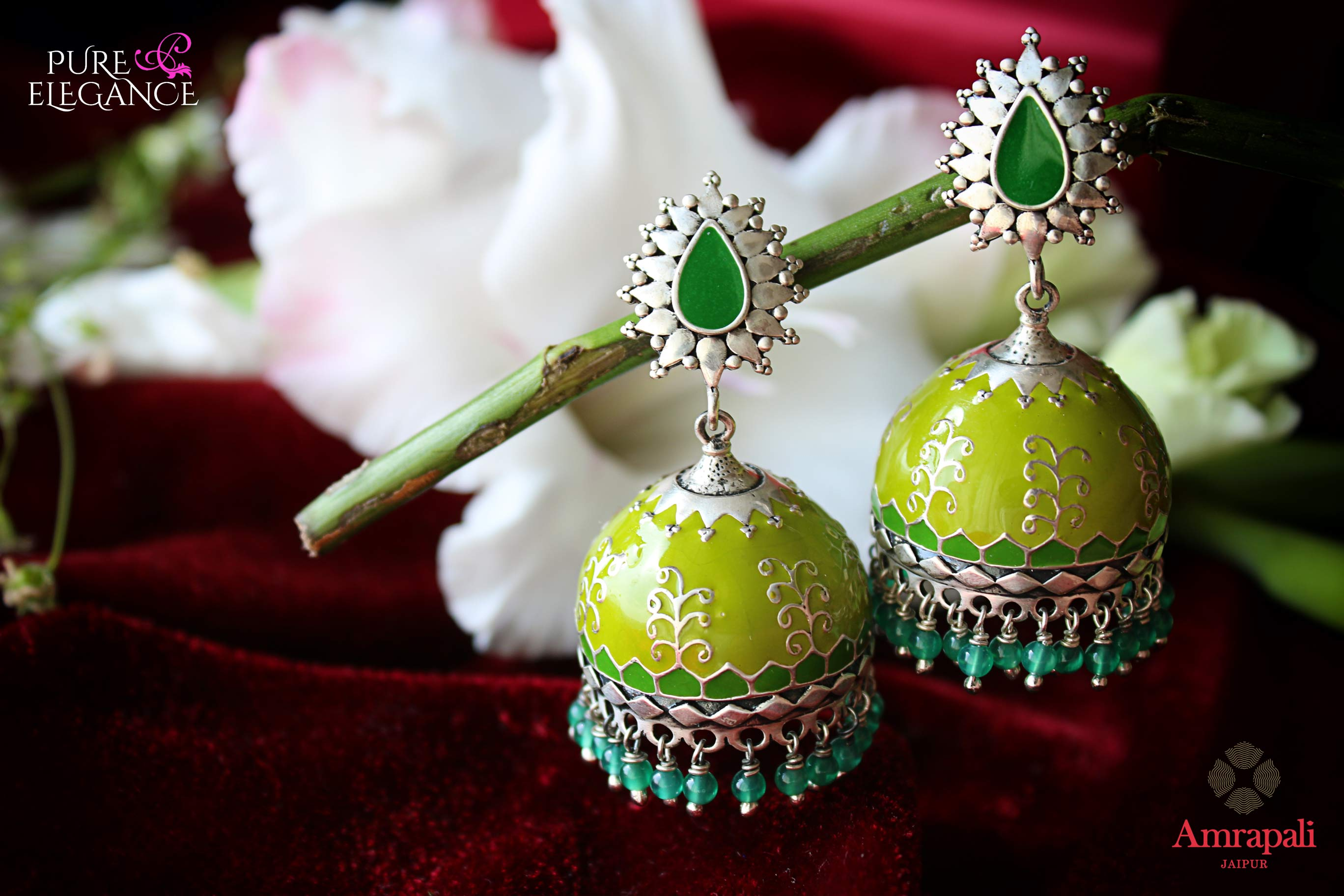 Shop Amrapali green enamel silver jhumka earrings online in USA with green beads. Bring out the best in your ethnic look with traditional Indian jewelry available at Pure Elegance fashion store in USA. We have a stunning variety of Indian gold plated earrings also available at our online store. Shop now.-full view
