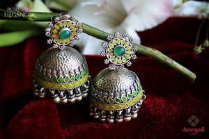 Shop Amrapali ethnic silver jhumki earrings online in USA with green enamel. Bring out the best in your ethnic look with traditional Indian jewelry available at Pure Elegance fashion store in USA. We have a stunning variety of Indian gold plated earrings also available at our online store. Shop now.-full view