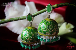 Shop silver green enamel jhumki earrings online in USA with green beads. Bring out the best in your ethnic look with traditional Indian jewelry available at Pure Elegance fashion store in USA. We have a stunning variety of silver earrings by Amrapali also available at our online store. Shop now.-full view